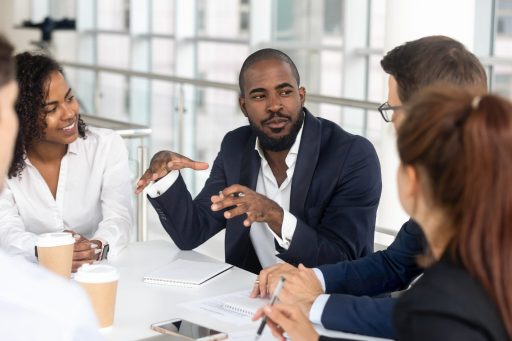 Millennial,Employees,Gathered,In,Boardroom,For,Training,,Black,Boss,Ceo